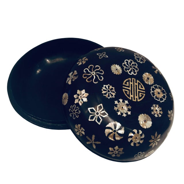 An adorable late 19th century round, black lacquer with mother of pearl Korean work box.