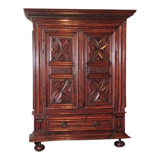 Late 17th Century French Louis XIII Carved Walnut Armoire With Fleur-De-Lys For Sale