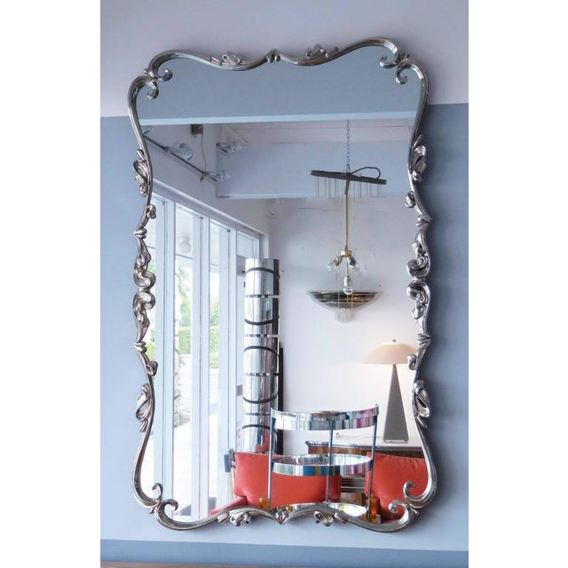 A very large Mid-Century mirror with stylized ornate metal frame. Great form and highly decorative. Could be hung...
