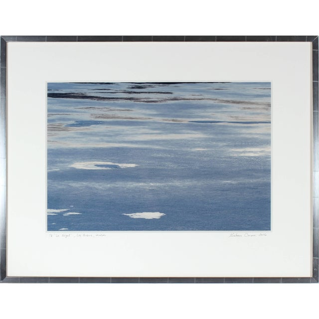 """Entitled """"Le Dégel"""" (Thawing), this 2016 archival abstract photograph of melting ice on a lake in the spring on Hahnemuhle..."""