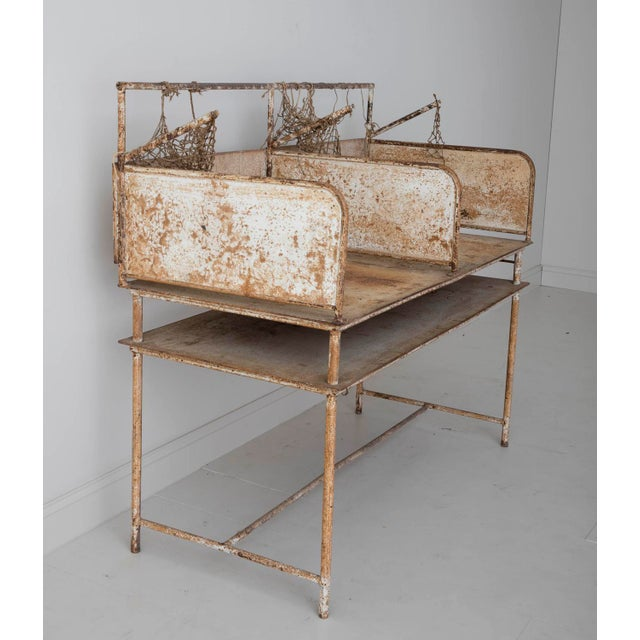 Very unique early 20th century iron oyster shucking table from the east coast with some of the original netting remaining....