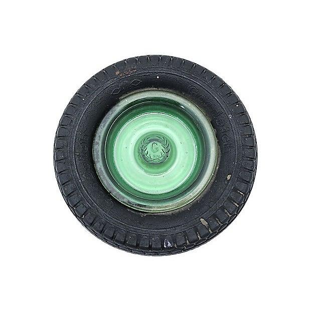 Goodrich rubber tire advertising ashtray. Maker's mark on top. Light wear, faint cracking in rubber.