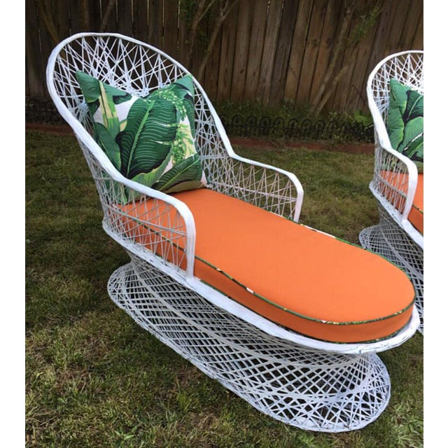 Gorgeous pair of vintage spun fiberglass chaises! Custom cushions. Seat cushion is a beautiful shade of orange with banana...