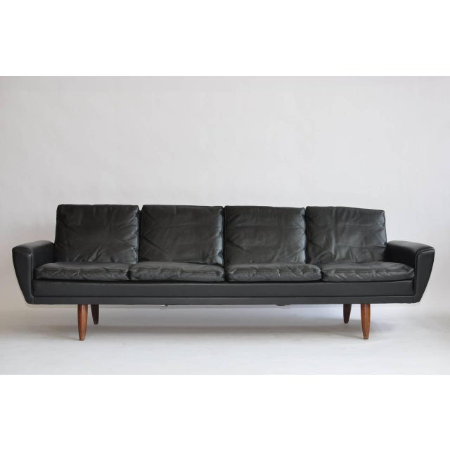 Danish leather sofa with rosewood legs.