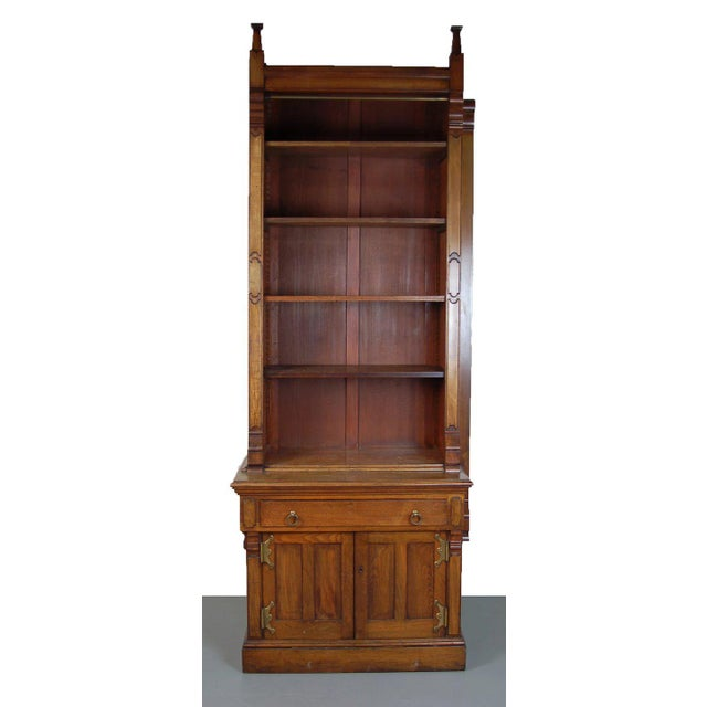 Beautiful Victorian renaissance Revival bookcase with paneled stiles and gothic finials.Has adjustable height shelves...