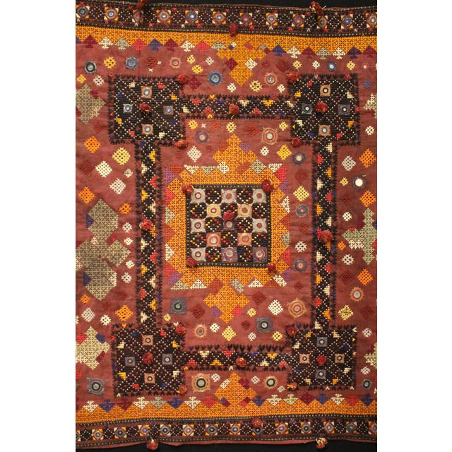 Framed Middle Eastern vintage textile. Tapestry intricately embroidered. Mounted on black fabric and framed in a black and...