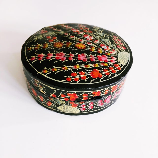 Lovely set of hand-painted floral paper mache coasters. Set of 6 coasters and matching decorative storage box. Each...