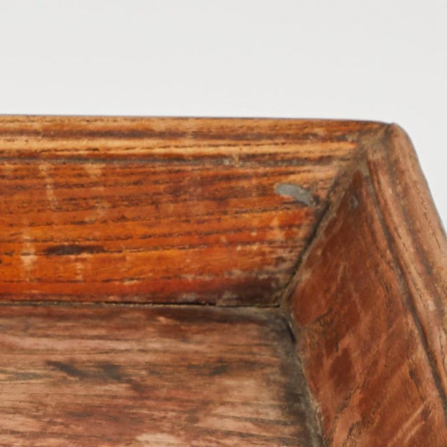 Primitive wooden Chinese tray from late 19th century China.