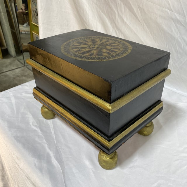 Black and gold hand painted wood box with nautical compass motif on top. Great accessory.