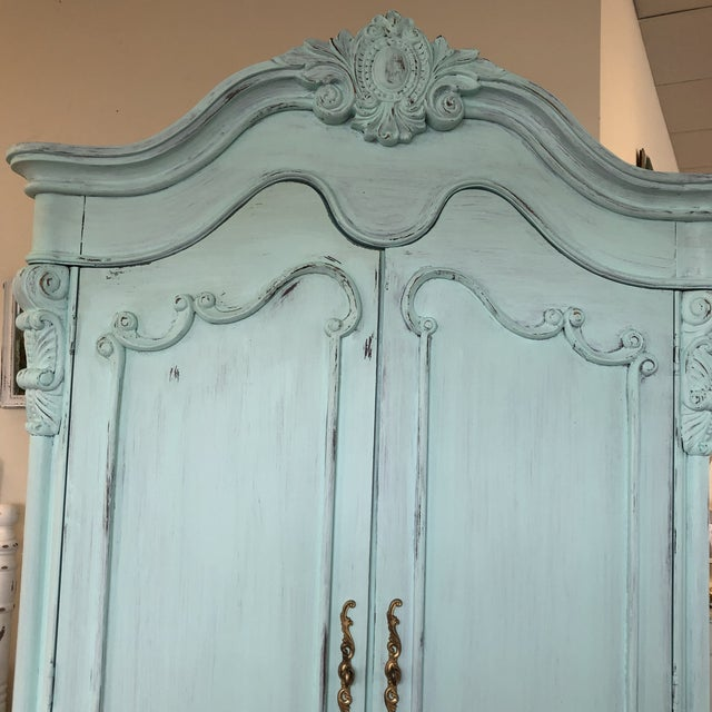 Stunning French Provencal style very large amoire in a soft pale aqua color and light distressing. Gorgeous carved...