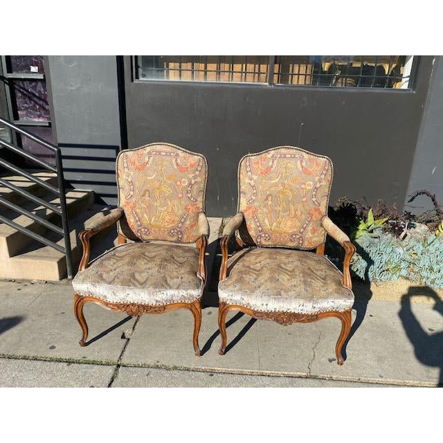 Pair of 19th Century French Walnut Petite Point Neelde Point Arm Chair. Perfect for a traditional style home.