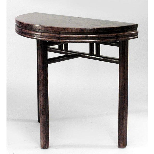 Pair of Asian Chinese style (19th Cent.) teak half round 3 legged console tables with fluted apron