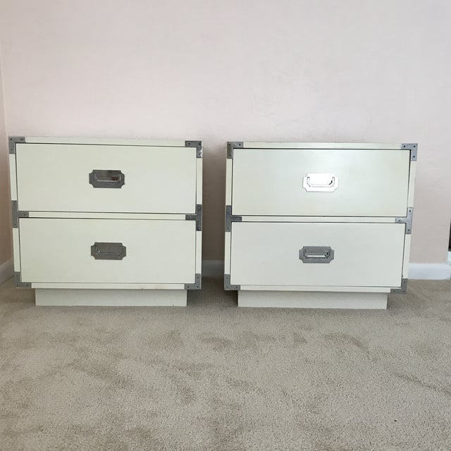 Two Dixie campaign nightstands from the mid-century from an estate in SW Florida. Features an original white finish with...