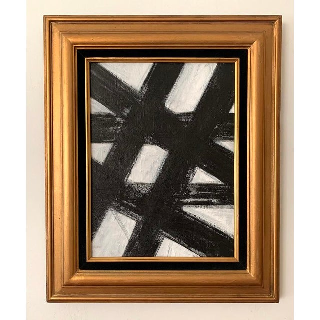 This original acrylic painting on canvas is inspired by Franz Kline. This bold black and white artwork is framed in a...