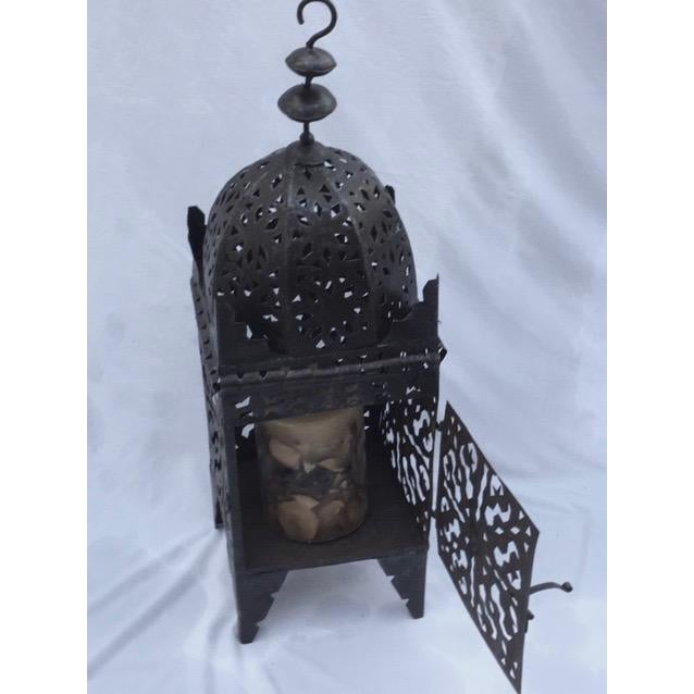 Moroccan metal work lantern. Great for use hanging floor arrangements or table top. Minor wear consistent with age and...