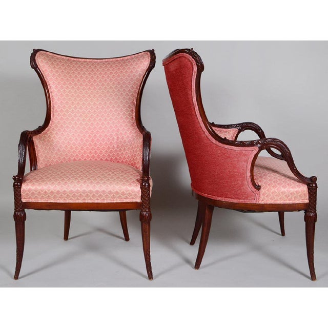 These are a very nice pair of vintage arm chairs in mahogany , The curved backs with leaf carved arms circular slightly...
