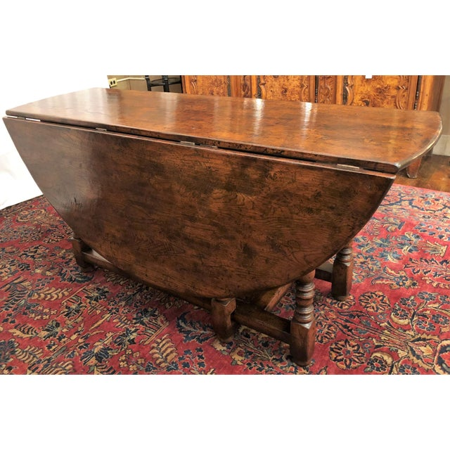 """English Drop Leaf Yew-Wood Round Table Closed Dimensions: 19-1/2"""" Wide x 64-1/2"""" Long"""
