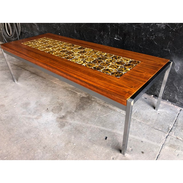 This is a very solid Danish tiled coffee table or also would work for and amazing bench.