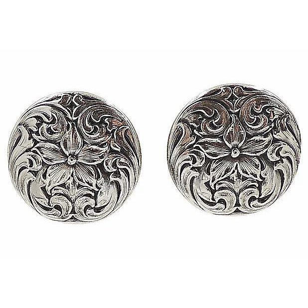 "1960s Napier silvertone floral clip-back earrings. Marked ""Napier."" Measure: 1.13 inches W. Excellent condition. Due to..."