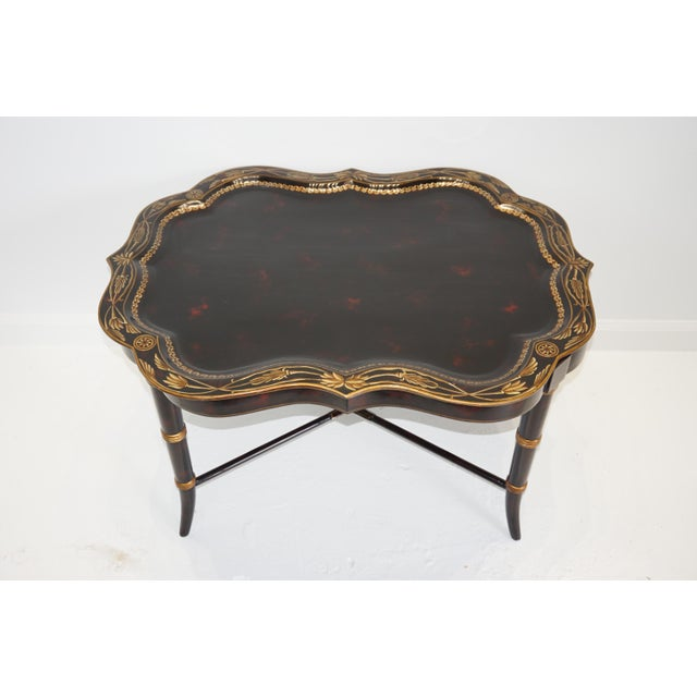 Regency style papier mache tray table. In two parts, with gilt surround and subtle marbleized tray on a painted and...