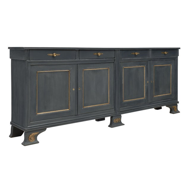 Louis Philippe antique French buffet made of fir wood featuring four dovetailed drawers and four doors opening to...