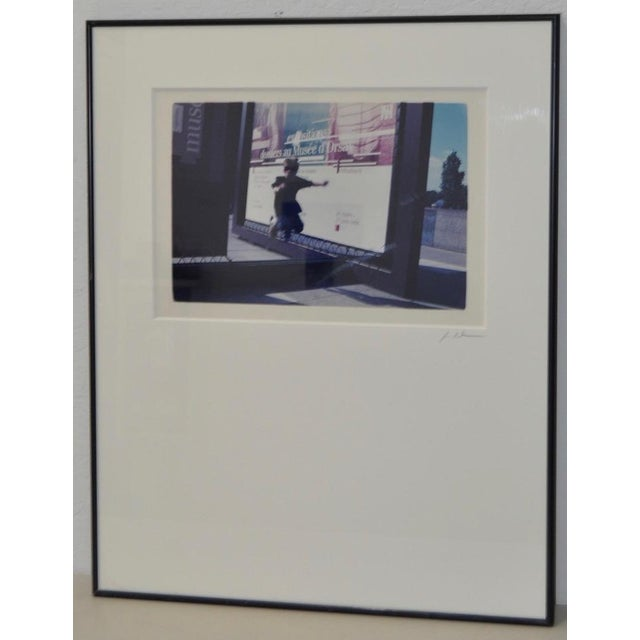 Vintage Color Photograph Child Jumping in Front of French Museum Poster c.1990s Matted and framed photograph. The mat has...