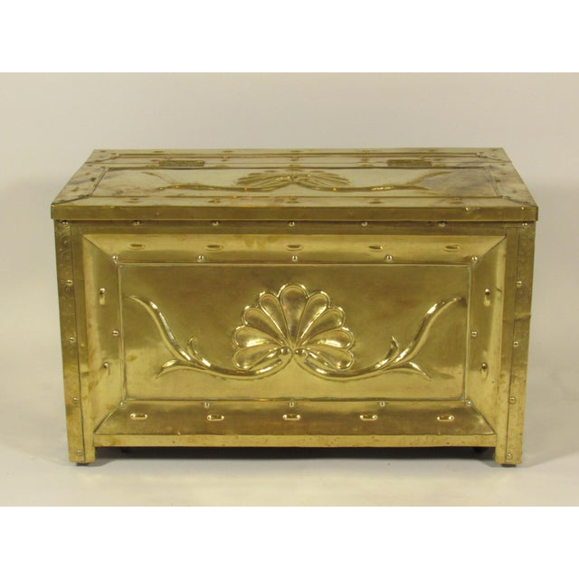 A late 19th century Swedish repouse brass bound wood box with hand hammered foliate details, brass carrying handles and...