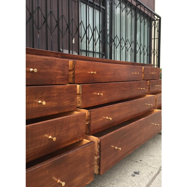 Mid Century Lowboy with Dotted Brass Knobs with a total of twelve drawers. Made of walnut wood, the over all tone carries...