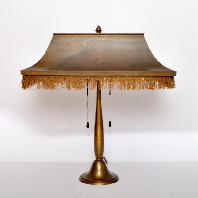 A time-licked Chinese roof inspired desk lamp from a former Swiss design and manufacturing firm BAG TURGI. The...
