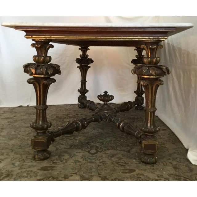 This elegant table has a French carved and polychrome Neo-Classic base and beautiful Carrara marble top. It was designed...