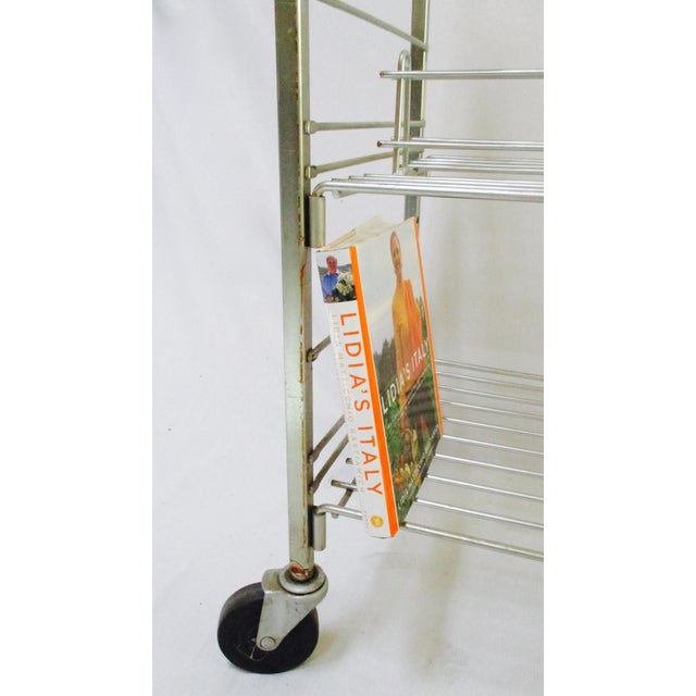 A uber cool, heavy, Industrial machine age metal rolling rack cart trolley shelves . Spectacularly designed and...