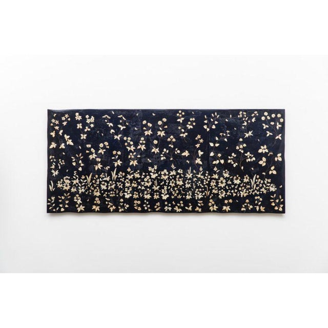 Float, a large carved wallhanging, draws inspiration from the unicorn tapestries in the collection of the Victoria and...