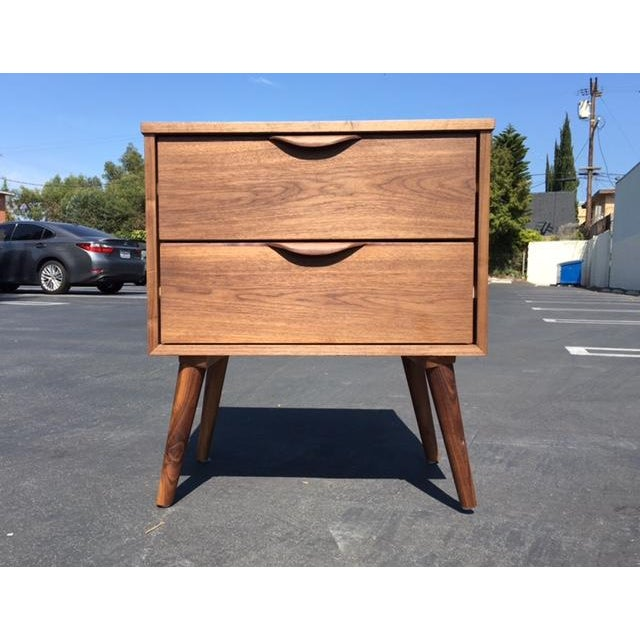 A individual custom mid century nightstand in great condition. Two pull out drawer. Walnut finished.