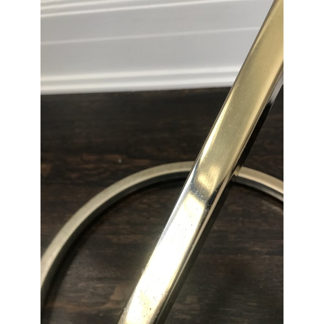 Mid century side table in the manner of Pace Collection. Gold plated curved base.