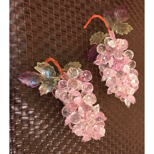 Two Mid-Century modern bunches of pink and clear faceted grapes.