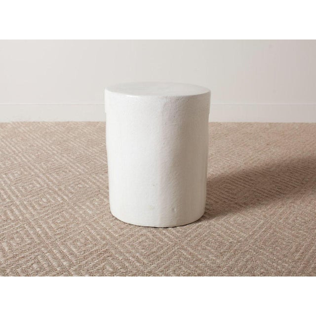 White glazed ceramic stool with two hand holes. Solid heavy construction. Quantities available.
