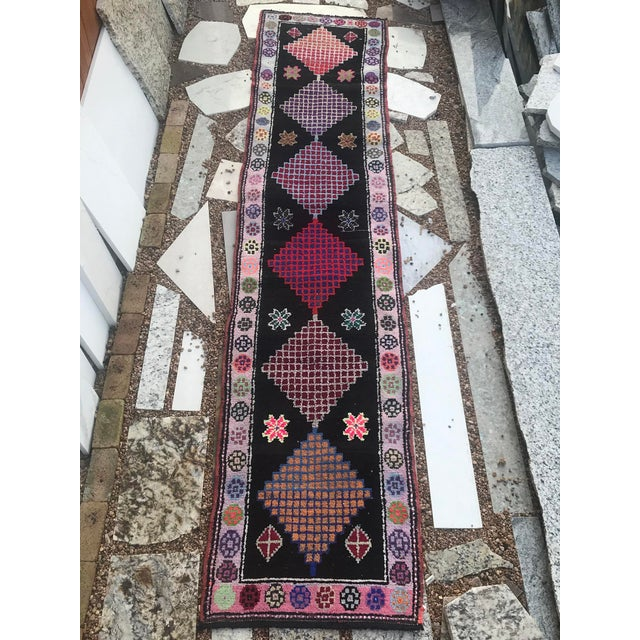 This great rug has a lot of character. The diamond design in the field is full of crosshatches and is very colorful. The...