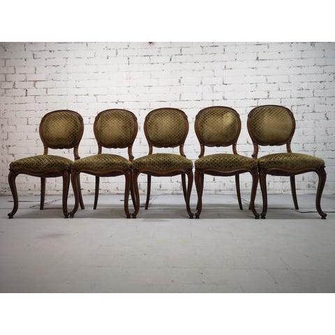 Beautifully carved walnut balloon back set of 5 dining chairs. Oval padded backs with lovely decorative carved elements,...