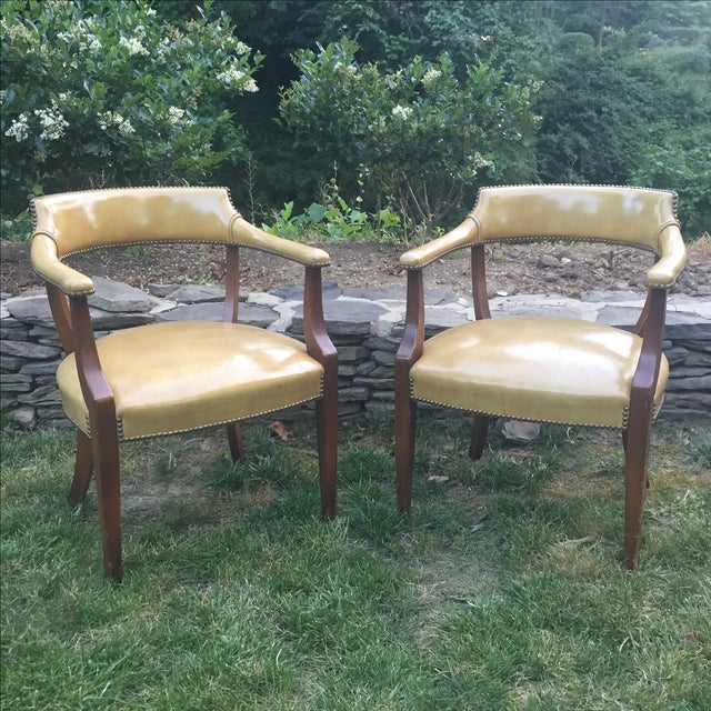 "Vintage pair of hickory leather nail head library chairs in a beautiful caramel color. Seat height is 17"" Arm height is..."
