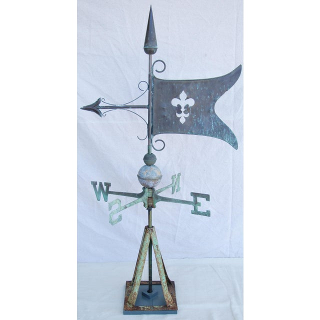 French Fleur de lis copper flag weathervane with N, S, W, and E directionals. Weathervane has custom wood and iron tripod...