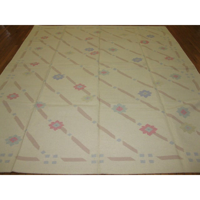 This is a beautiful new hand woven reversible Indian Dhurrie rug with a simple all over pattern in pastel colors. It is...