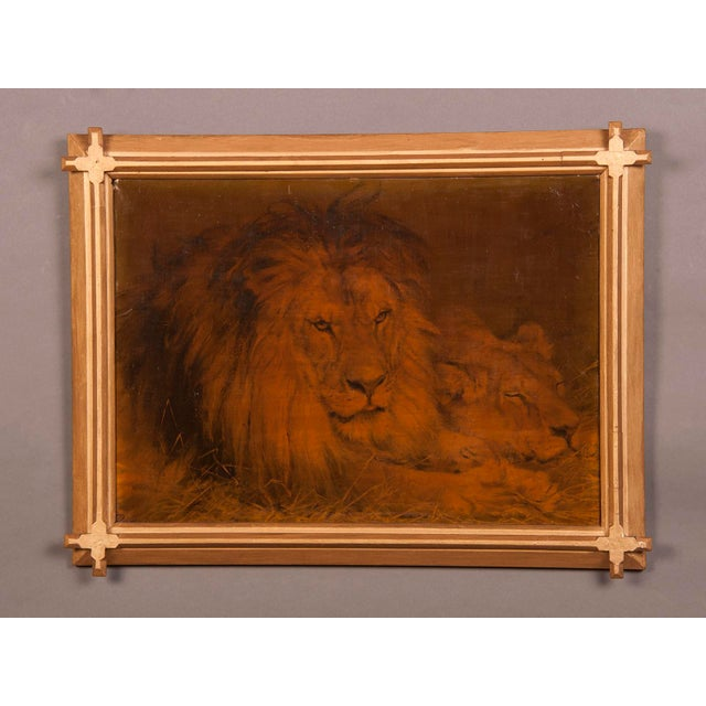 A mysterious oil on canvas painting depicting a reclining lion, the king of animals, within the original gilded frame with...