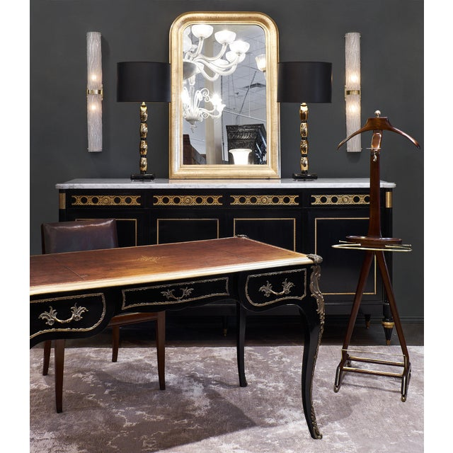 A sumptuous buffet/enfilade. This stunning credenza features four doors, four drawers, a white lightly veined Carrara...