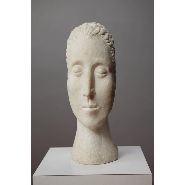 Portuguese pink marble sculpture showing a woman's bust. A modern 20th century interpretation as an homage to the classic...