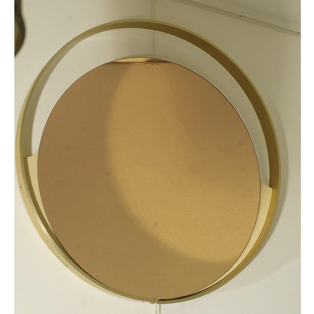 A 1970s Italian Round Mirror with Bronze Tinted by Rimadesio Conditions : very good MEASUREMENTS diameter: 80cm (31.49in.)