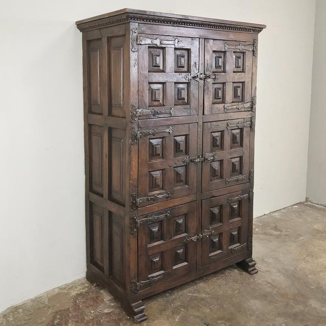 19th Century Spanish Cabinet was designed as a kitchen cabinet, and created from framed heavily chamfered panels affixed...