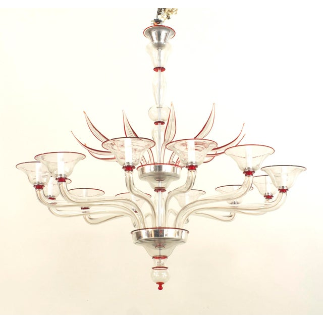 Italian Venetian Murano 1940s style (modern) clear glass and red trimmed chandelier with 12 scroll arms under a tier of 12...