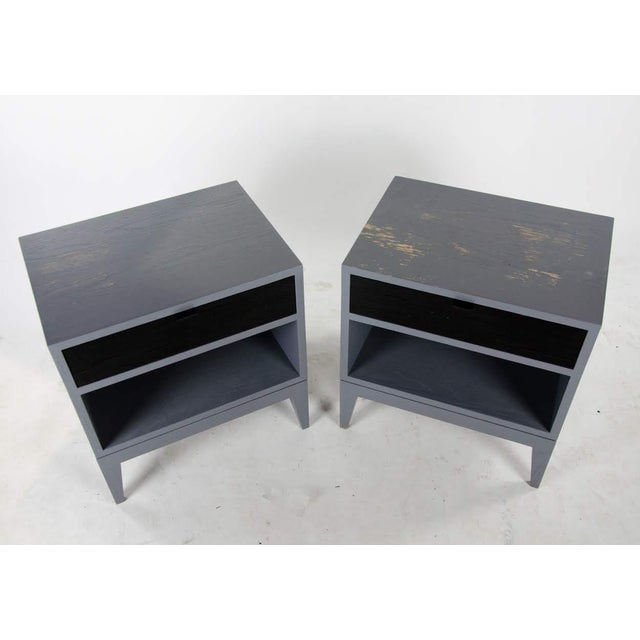 Bring a bit of funky flair to your bedside with this pair of Mid-Century black mosaic front side table stands. The top...