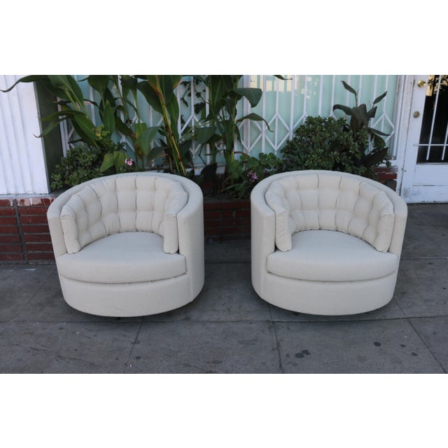 Milo Baughman Style pair of Swivel Chairs just reupholstered. They both swivel well. Both are tufted and reupholstered...