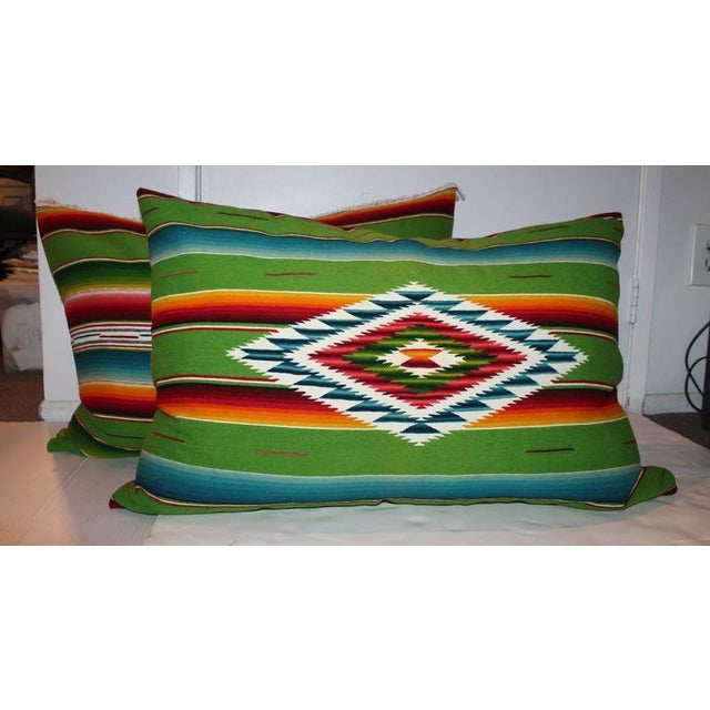 These vibrant large bolster pillows are amazing and one has the center motif and one in back is all stripes. The backings...